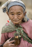 Asia, old woman with chicken Stock Image
