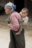 Asia, old woman with chicken and grandson Stock Images