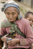Asia, old woman with chicken and grandson Stock Photos