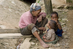 Asia, old woman with grandchildren Stock Image