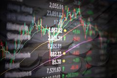 Asia Pacific stock market data and candle stick graph chart on monitor on coins background. Business or finance concept : Asia Pacific stock market data and Royalty Free Stock Photography