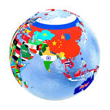 Asia on political globe with flags isolated on white. Asia on political globe with national flags embedded in map. 3D illustration isolated on white background Stock Photos