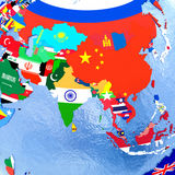 Asia on political globe with flags Stock Photos
