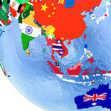 Asia on political globe with flags Royalty Free Stock Photos
