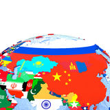 Asia on political globe with flags Royalty Free Stock Image