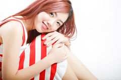 Asia pretty girl in red white dress sit on floor. In studio white background Stock Image