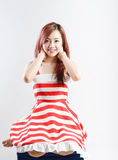 Asia pretty girl in red white dress sit on floor. In studio white background Royalty Free Stock Photo
