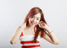Asia pretty girl in red white dress sit on floor. In studio white background Stock Photo