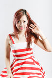 Asia pretty girl in red white dress sit on floor. Stock Photos