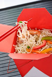 Asia rice noodles in a red box, chopsticks Royalty Free Stock Images