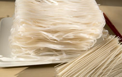 Asia rice noodles. Stack of Asia rice noodles on the table royalty free stock photography