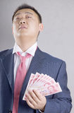 Asia rich man. Hold lot of money Royalty Free Stock Photography
