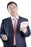 Asia rich man. An Asia guy holds money Royalty Free Stock Images