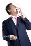 Asia rich man kisses money. An Asia guy kisses his money stock image