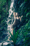 Asia sexy girl under relaxing hot waterfall Royalty Free Stock Photo