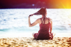 Asia woman sitting and posing on beach sand. Portrait of asia beautiful woman sitting and posing on the beach sand stock photo