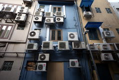 ASIA SINGAPORE CITY AIR CONDITIONERS. Aircondition on a building in the city of Singapore in Southeastasia Royalty Free Stock Image