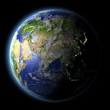 Asia from space. Asia from Earth's orbit in space with evening light and visible city lights. 3D illustration with detailed planet surface. Elements of this Stock Photography