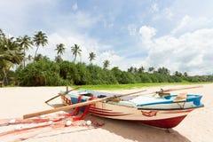 Sri Lanka - Ahungalla - A fishing boat at the beach Stock Photos
