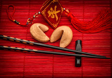 Asia style background lucky charm, fortune cookies chopsticks Royalty Free Stock Photo