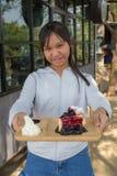 Eat blueberry cheesecake. Asia teenage girl filed the blueberry cheesecake comes in front Royalty Free Stock Photography