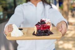 Eat blueberry cheesecake. Asia teenage girl filed the blueberry cheesecake comes in front Stock Photo