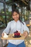 Eat blueberry cheesecake. Asia teenage girl filed the blueberry cheesecake comes in front Stock Image