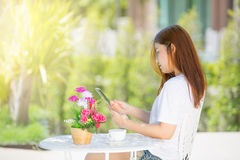 Asia teenager Women  using her tablet. Royalty Free Stock Photo