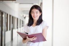 Asia thai china student university beautiful girl read a book Stock Image