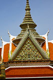 Asia  thailand  in  bangkok sunny   religion      mosaic. Asia  bangkok in   temple  thailand abstract cross colors roof  wat    sky   and    colors religion Stock Image