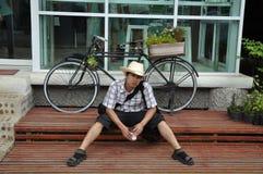 Asia Thailand Man Cowboy Sit Stock Image