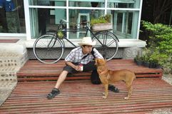 Asia Thailand Man Cowboy Sit With Dog Stock Photography