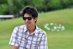 Asia Thailand Man Sit Smile  Sunglasses Stock Images