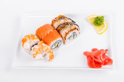 Asia. Tokyo rolls with shrimp, eel and salmon on a white plate o Royalty Free Stock Photos