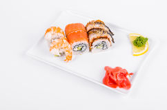 Asia. Tokyo rolls with shrimp, eel and salmon on a white plate o Royalty Free Stock Photography