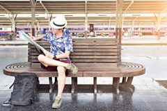 Asia tourist looking a map for travel by the train. Travel concept stock photos