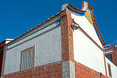 Asia traditional bricks buliding in Taiwan with loudspeaker and. Blue sky Stock Image