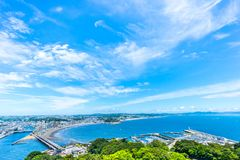 Enoshima island and urban skyline view in kamakura. Asia travel concept - the famous travel place, enoshima island and urban skyline aerial panoramic view under royalty free stock photos