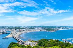 Enoshima island and urban skyline view in kamakura. Asia travel concept - the famous travel place, enoshima island and urban skyline aerial panoramic view under stock photo