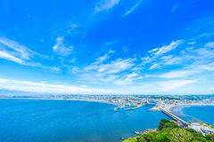 Enoshima island and urban skyline view in kamakura. Asia travel concept - the famous travel place, enoshima island and urban skyline aerial panoramic view under stock images