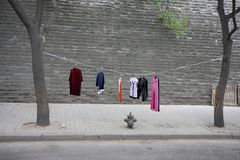 Asia Travel. A makeshift clothesline is seen along the city walls in Xi` An, China Stock Image