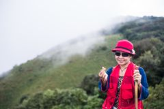 Asia trekker woman in red royalty free stock image