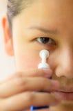 Asia woman applying anti-aging serum. On her skin Stock Images