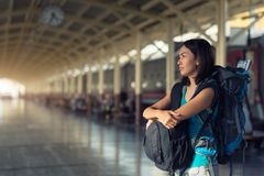 Asia woman with bag backpack, bored waitting time for traveler t stock images