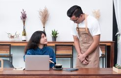 Asia woman customer complaining to waiter about food in cafe res. Asia women customer complaining to waiter about food in cafe restaurant,unhappy emotion service royalty free stock image