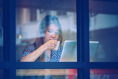 Asia woman drink coffee and working on laptop in cafe Stock Photo