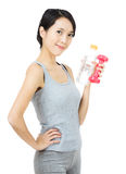 Asia Woman with dumbbell and water bottle Royalty Free Stock Photos