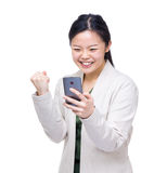 Asia woman feeling excited when reading message on mobile Royalty Free Stock Photos