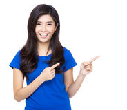 Asia woman finger introduce something Stock Photo