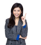 Asia woman finger pointing up Royalty Free Stock Photos